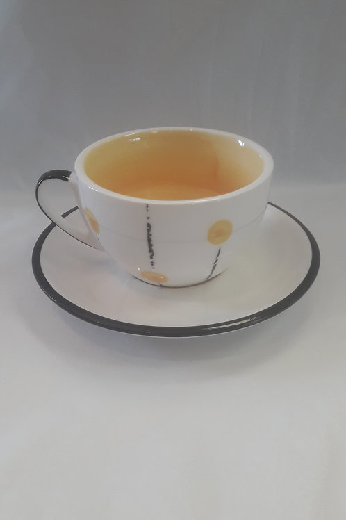 Yellow lollipop cup and saucer