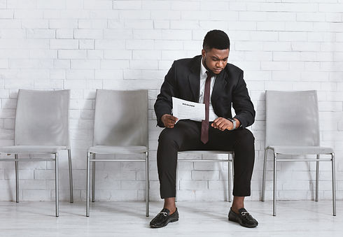 serious-black-businessman-with-resume-wa