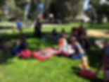 parents and kids playing in park