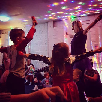 children dancing with carrie wearing costumes under disco lights