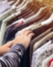 woman-browsing-through-clothing-at-secon