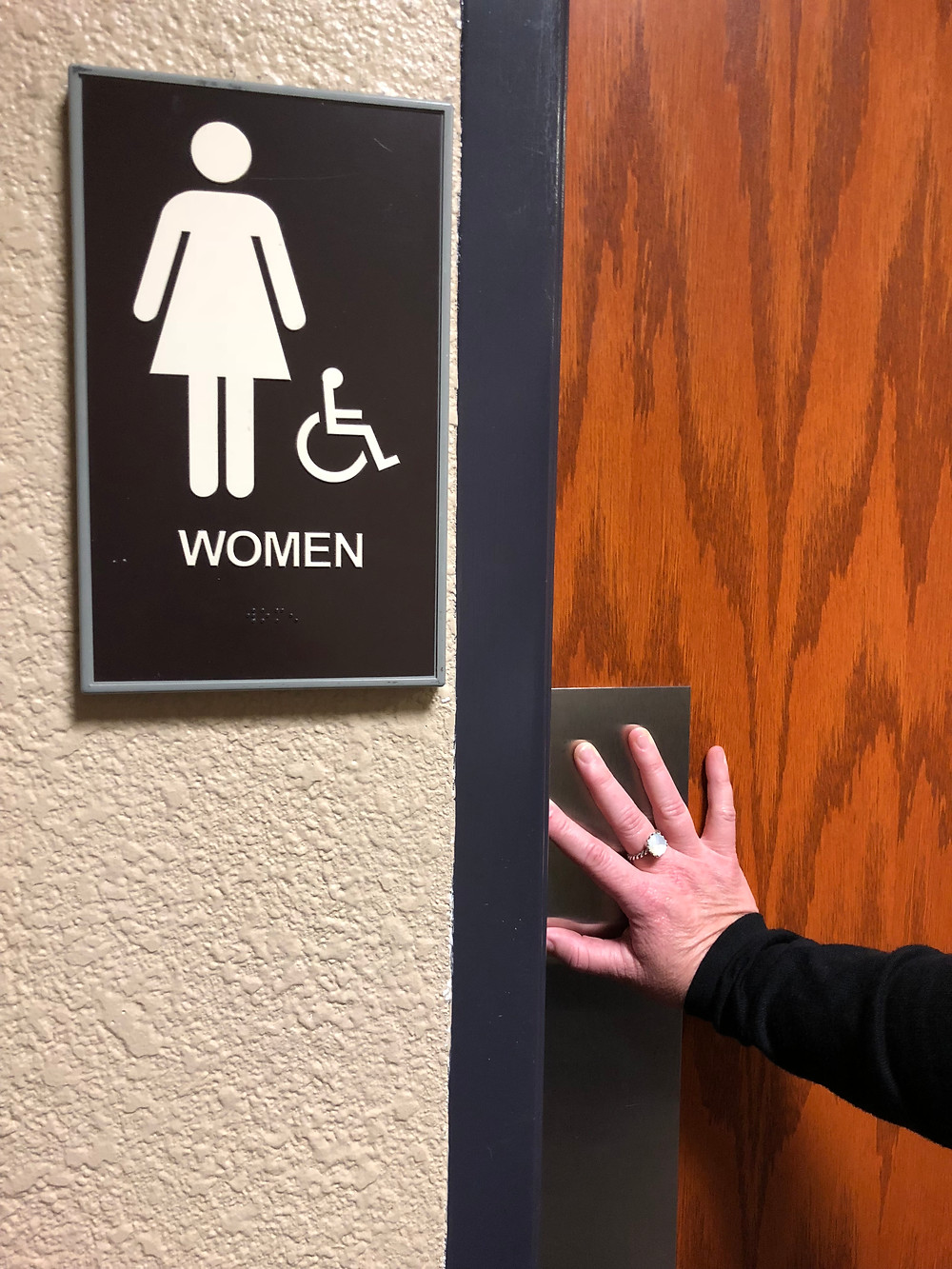 woman going into the women's restroom