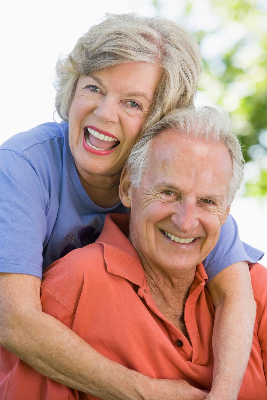 older couple together smiling for the camera