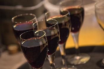 Red wine-filled glasses on a drinks tray