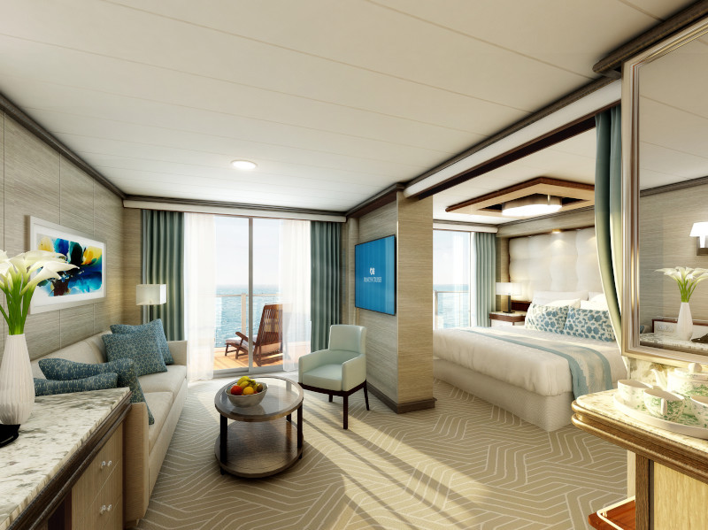 Tan, white and blue decor in two room suite with balcony