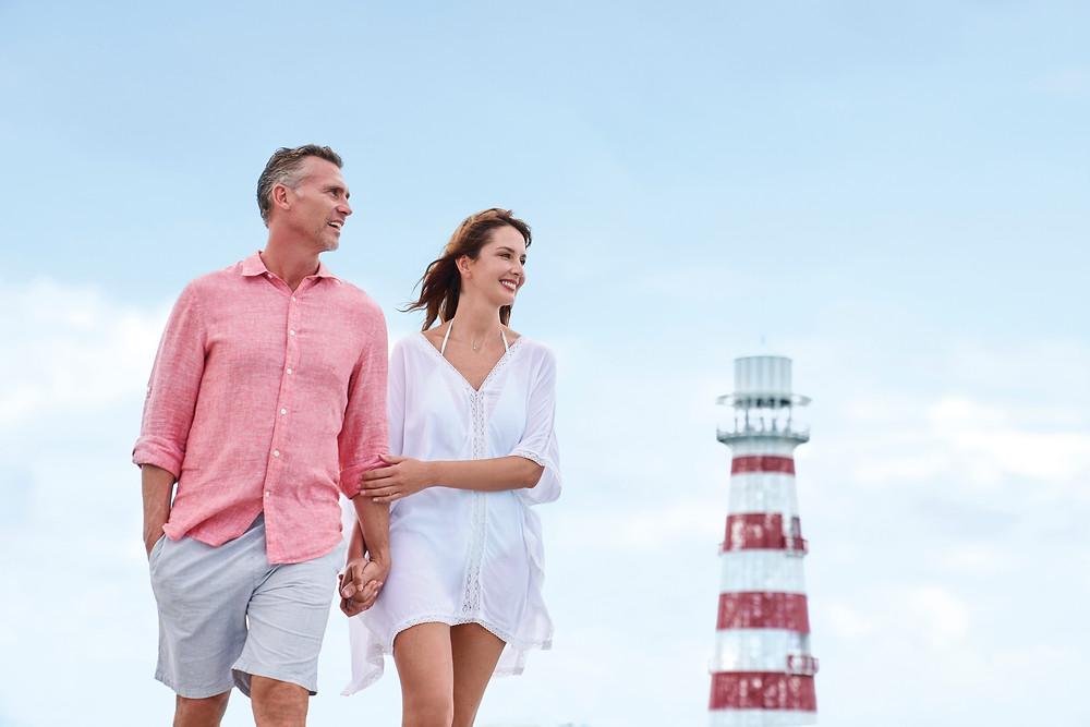 man woman holding hands lighthouse