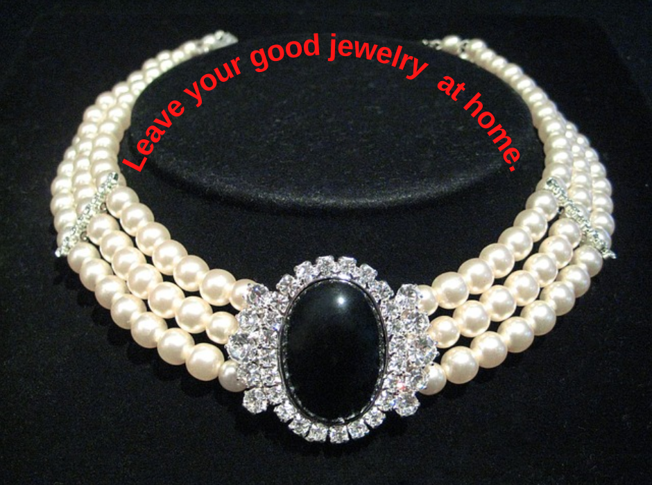 """pearls on black background with quote saying """"leave your good jewelry at home."""""""