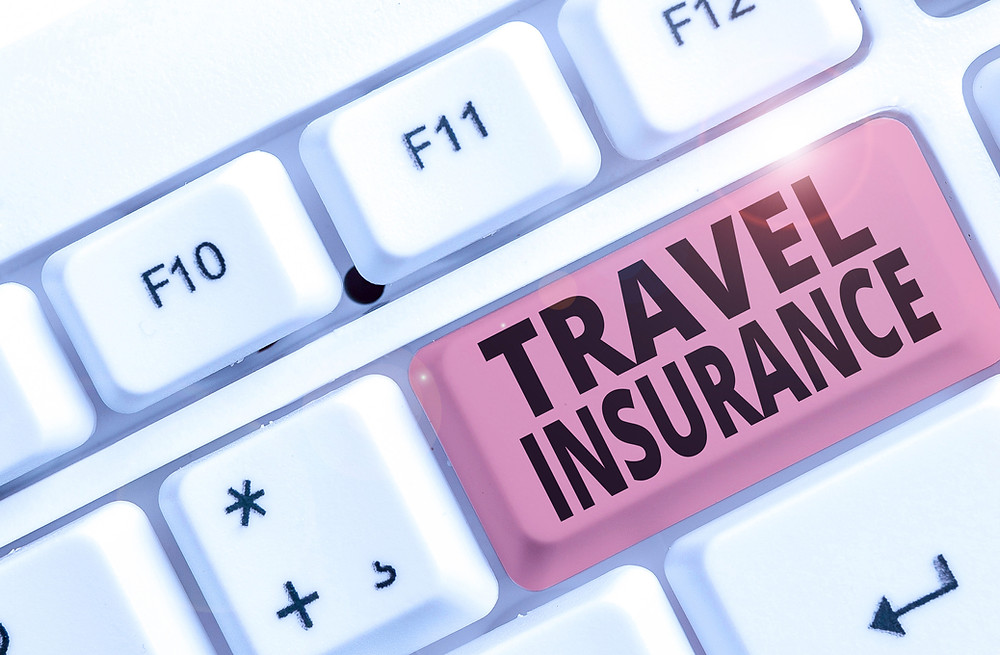 keyboard key says travel insurance