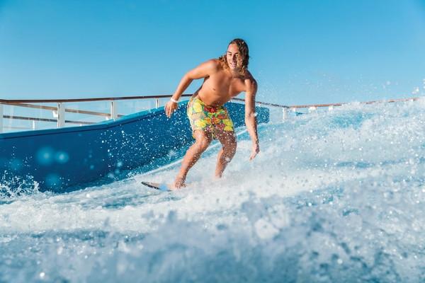 Man surfing on a cruise ship Flowrider.