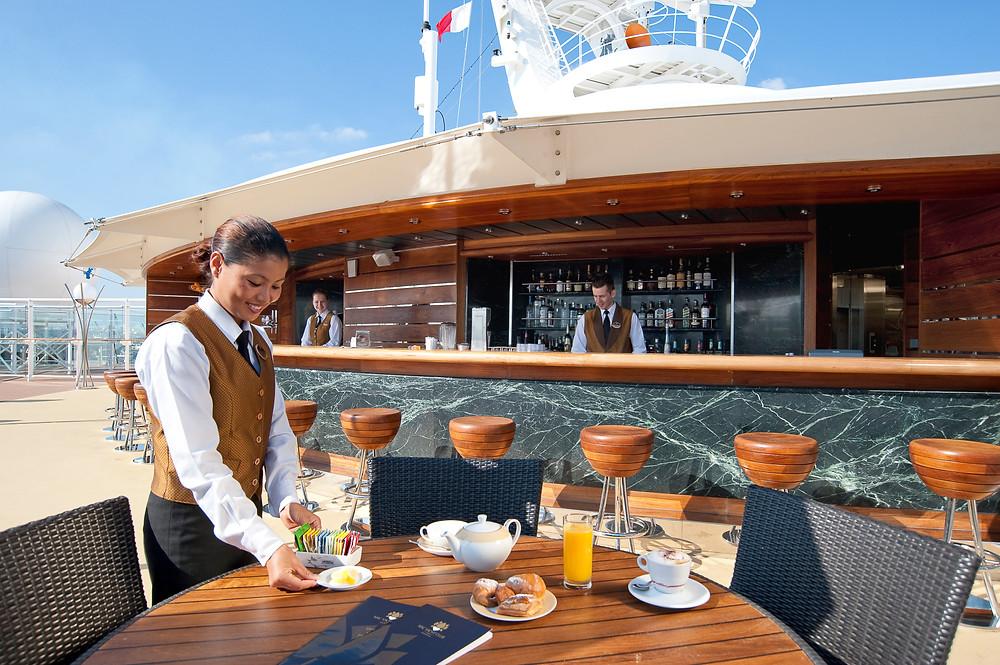 MSC yacht club pool deck waitress table