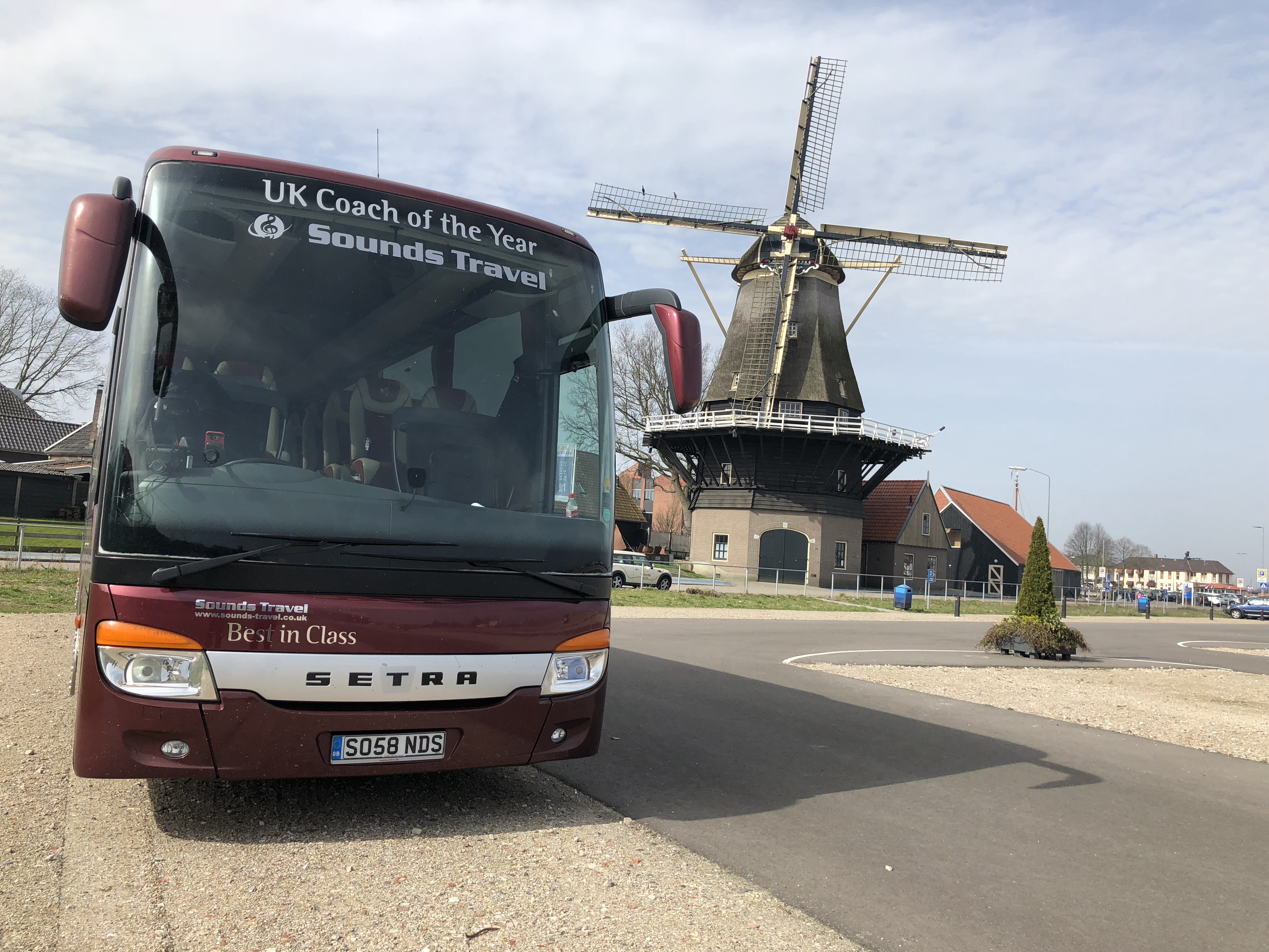 Sounds Travel Coach next to Dutch Windmill