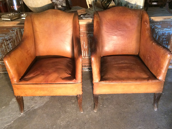 Paire fauteuils cuir
