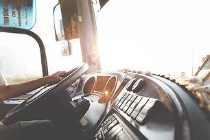 person-hand-on-steering-wheel-977213.jpg