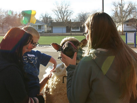 FFA members teach young students about agriculture so they can grow up to be informed consumers