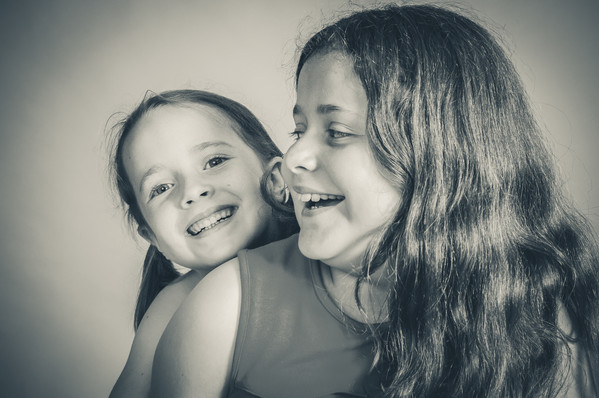 Sisters being cheeky