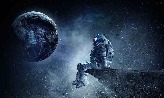 Spaceman on rock edge.jpg