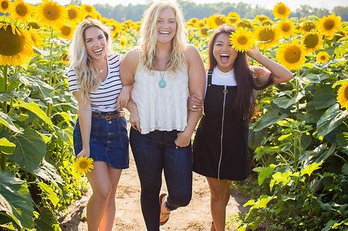 Girls in Sunflower Field Stock (2).jpg