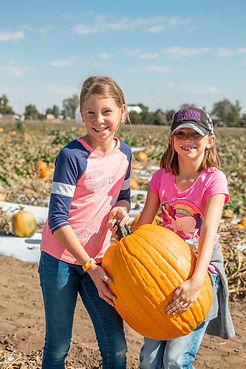 Fritzler Girls picking up pumpkin.jpg