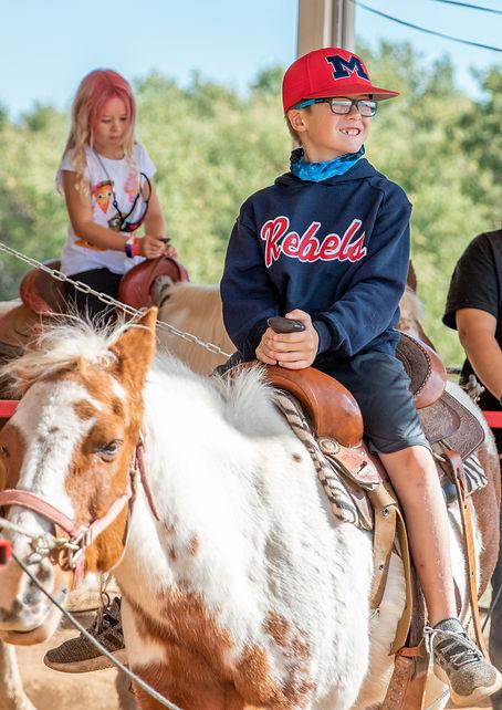 Orr boy & girl riding ponies.jpeg