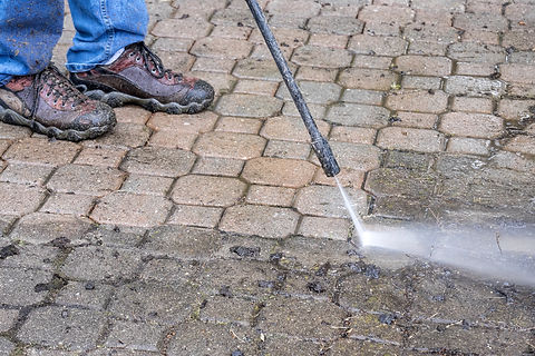 Man Washing Patio with a Power Washer.jp