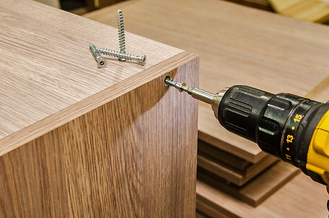 the process of furniture assembly screws