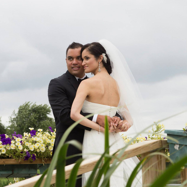 Bride & Groom with floral background