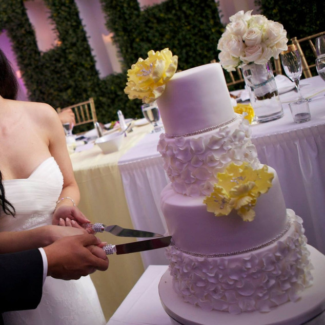 Wedding cake with center piece in background