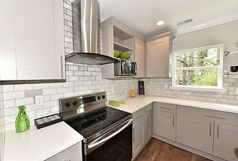 Remodeled Kitchen Grey Cabinets Marble Backsplash Quartz Counters