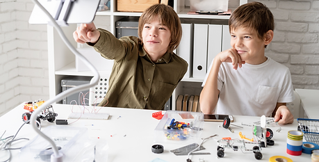 young-boys-having-fun-making-robot-cars-