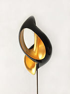 decorative sculpture in lacquered wood with interior covered with gold leaf inspired by the shape of the turritella