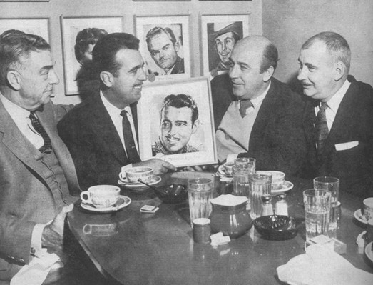 L-R: Getting framed at The Brown Derby with Bob Cobb, Ernie, artist Nick Volpe and Lee Gillette