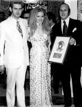 Lynn and Glenn with Clive Davis and the 'Rose Garden' Gold Single