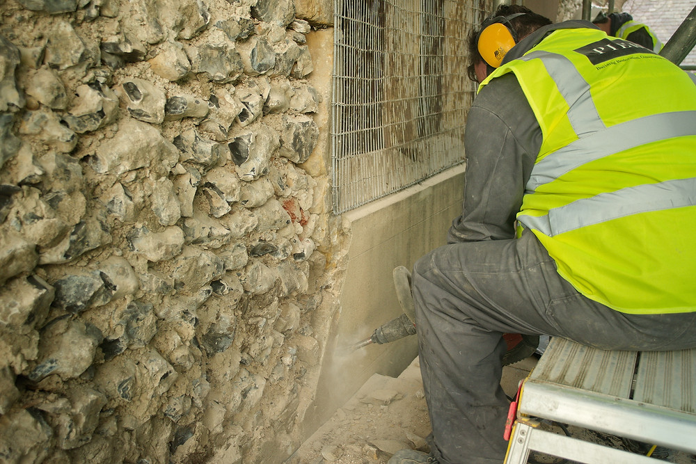 Above - a Putlock hole. Below - removing render from Chancel East end