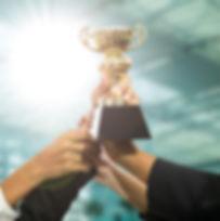 JAHF-Award-image_hands-holding-up-a-trop