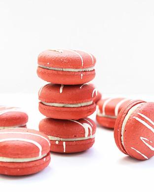 Vegan macarons Red Velvet with white chocolate ganache and cherry coulis.