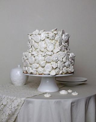 Vegan Dacquoise cake with raspberries.