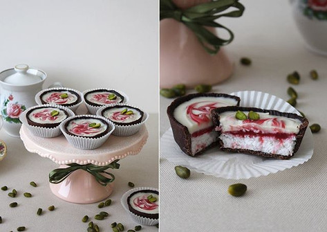 Vegan chocolate tartlets with coconut filling, raspberry curd, ganache with the white chocolate, pistachio. (Gluten free, sugar free)