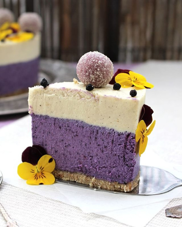 Raw vegan blueberry - vanilla cake with macadamia nuts and almonds.
