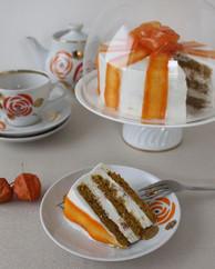 Vegan carrot cake with orange frosting.