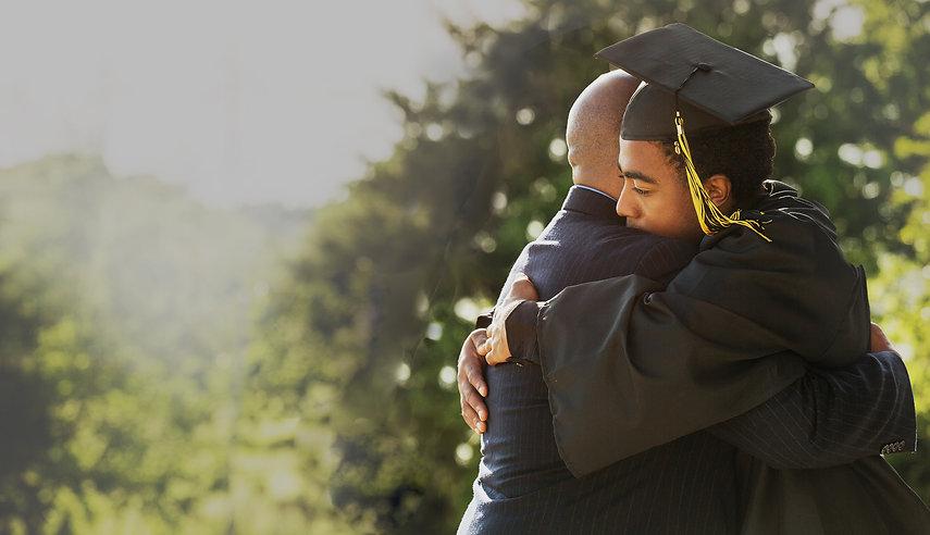 Boy hugging father-homepage grad.jpg