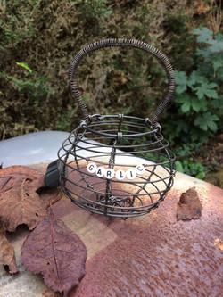 mini basket on rust surface_edited.jpg