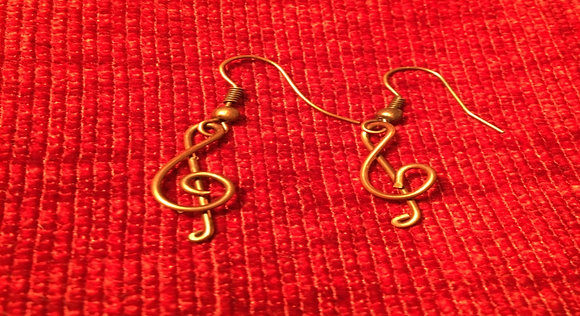 Treble clef earrings in  copper