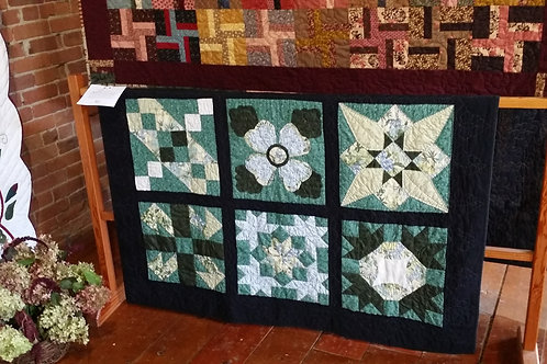 Hand pieced, hand quilted wallhanging or throw