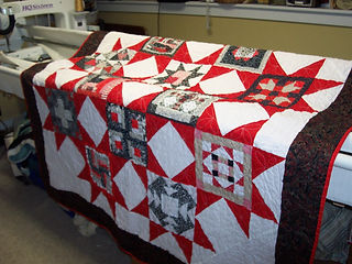 My Handiquilter longarm can handle quilted items from table runners to kind size quilts