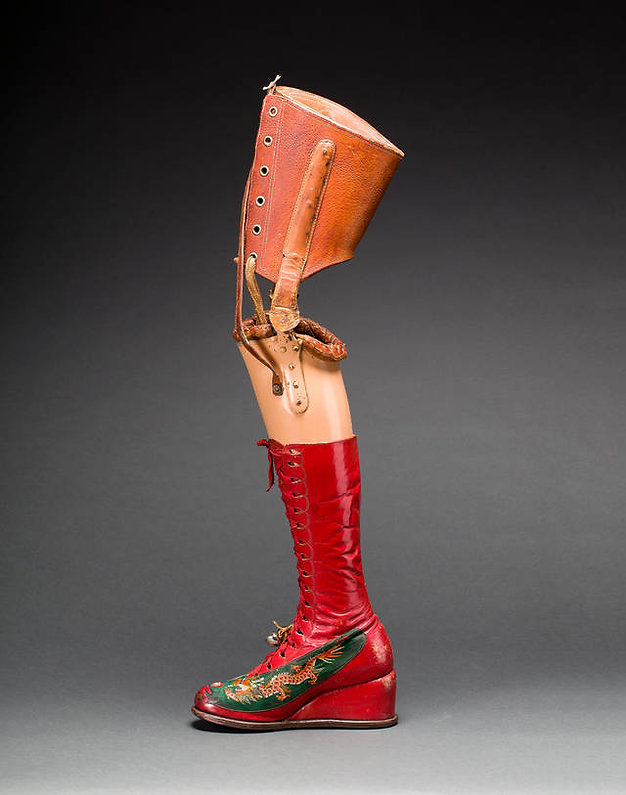 prosthetic leg with leather boot.jpg