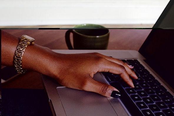 black-woman-hand-on-laptop-refurbished-laptop.jpg