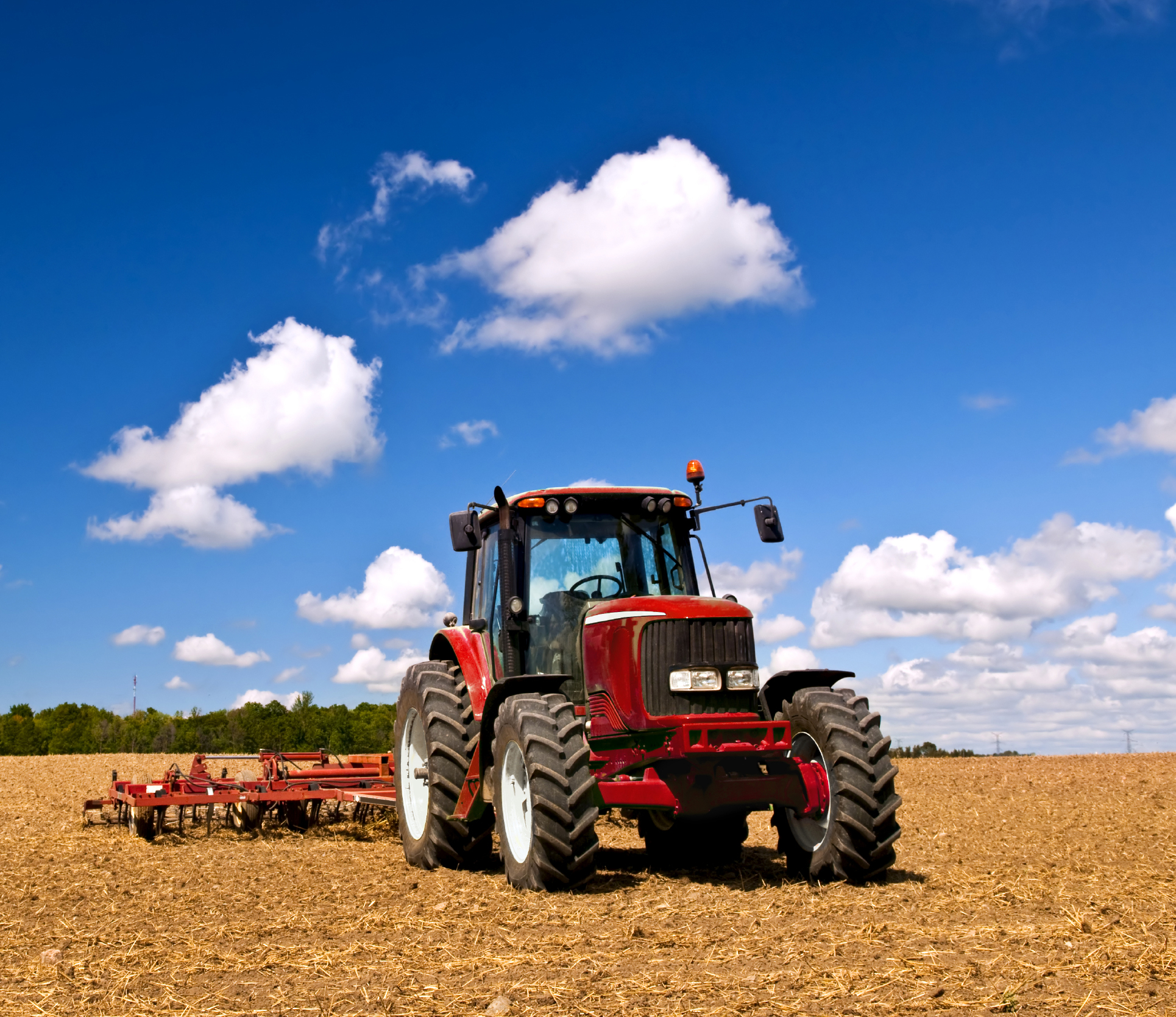 Tractor-in-plowed-field-000011916975_Large