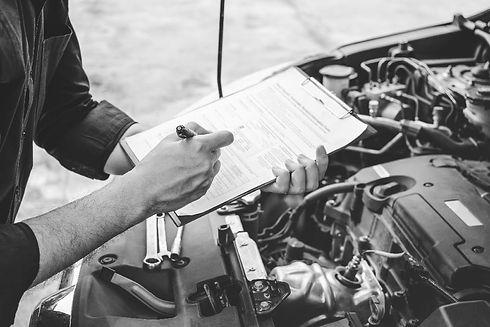 mechanic-checking-clipboard-bw-min.jpg