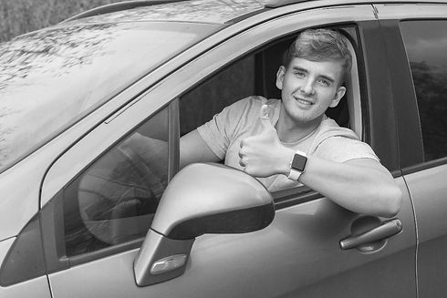 happy-customer-driving-bw-min.jpg
