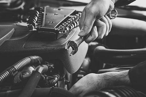 mechanic-fixing-car-bw-min.jpg